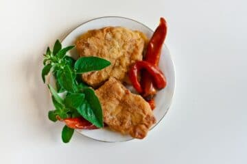 image of fish in a plate, image used in a blog written on the topic of health benefits of eating fish